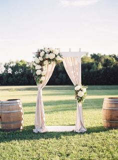 Floral Draped Ceremony Arch in Wine Country | Michael and Carina Photography | http://heyweddinglady.com/rustic-elegant-wine-country-wedding-inspiration-to-reality/