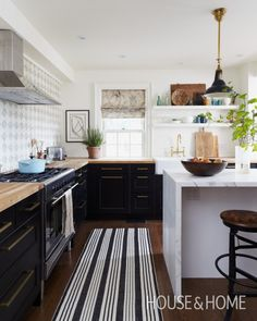 Light kitchen with dark  lower cabinets and floor | Rustic Soulful Kitchen | House & Home