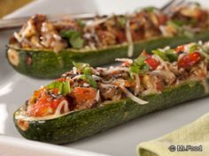 Italian Stuffed Zucchini Boats - Put those garden-fresh veggies to work with this flavorful dinner recipe for stuffed zucchini. The mix of spices with this one makes for one incredible dish!