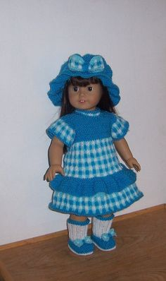 Gingham Check Outfit  This listing is my own design for a knitting pattern, for an outfit comprising of a hat, dress, and matching shoes and socks, the outfit features a three color, gingham check pattern that runs as a theme throughout the dress   Measurements To fit an 18 inch doll such as American Girl, Gotz, and similar size doll   Materials used 70grms of worsted weight (US), or DK (UK) in dark turquoise, 30grms of light turquoise and 30grms of white A pair of 5 (US), 9 (UK), 3.75 mm…