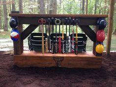 Backyard baseball bat rack, bar, and stadium seats for backyard batting cage fun !!