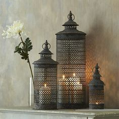 SET OF 3 TEMPLE LANTERNS Stunning distressed metal lanterns look great inside in a fireplace or outside for al fresco dining. Small lantern x cms Medium lantern x cms Large lantern x cms