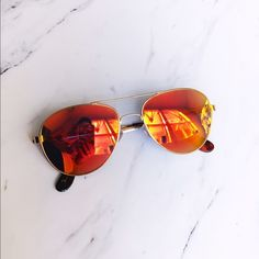 Anthropologie Orange Lens Aviator Sunglasses Perfect condition. Only worn a couple times! Bought in store. Very summery! Anthropologie Accessories Sunglasses