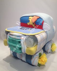 Car diaper cake for boy http://babyfavorsandgifts.com/little-car-diaper-cake-p-66.html