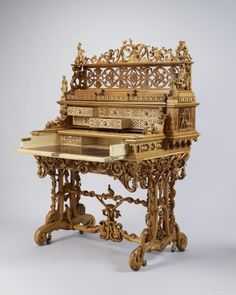 """1851 Swiss Writing table at the Royal Collection, UK - From the curators' comments: """"Queen Victoria and Prince Albert acquired this writing desk at the Great Exhibition. It was was praised for the quality of its carving, incorporating pursuits characteristic of the Canton of Berne, and the ingenious mechanism, allowing it to be used either standing or sitting. With the royal children in mind it was placed in the Swiss Cottage at Osborne.""""  Click the pin to see it configured for use standing…"""