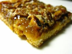 Pecan Pie Bars Ingredients: 1 can of refrigerated crescent rolls 1/2 cup chopped pecans 1/2 cup sugar 1/2 cup corn syrup (dark or light, doesn't matter) 1 Tbsp butter, melted 1/2 tsp vanilla 1 egg, beaten