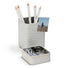 Tidy Desktop Organiser Pencil Cup Stationery Holder with Paper Clips, Binder Clips & 2 Mini Magnets by Monkey Business, http://www.amazon.com/dp/B003OYE7SA/ref=cm_sw_r_pi_dp_SlMIrb0RY3AR4