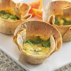 Whole-Wheat Spinach Ricotta Quiche Cups - Whole-Wheat Spinach Ricotta Quiche Cups are a delightful and impressive twist on traditional quiche. Whole-wheat tortillas are used to create individual crusts that are filled with a delicious combination of chopped spinach and cheeses. For another variation add finely chopped ham. Perfect for your next brunch or baby shower.