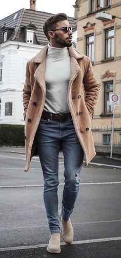 - with a fall outfit idea with sunglasses beige turtleneck suede shearling lined jacket brown leather belt slim cut distressed denim tan suede chelsea boots.