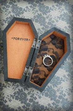 black halloween wedding ring box / http://www.himisspuff.com/halloween-wedding-ideas/10/