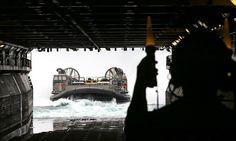 Landing craft air cushion approaches the well deck of USS Kearsarge (LHD-3) - Wasp-class amphibious assault ship.