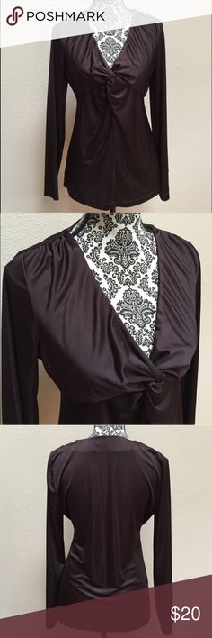 """Calvin Klein brown long sleeve top Calvin Klein long sleeve chocolate brown top in gently worn condition. Size medium. Approximate chest measurement is 19"""" and length is 26"""". Calvin Klein Tops Blouses"""