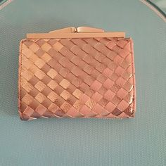 URBAN OUTFITTERS Pink metallic weaved wallet Pink, gold, and rose gold weaved design Urban Outfitters Accessories