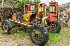 vintage open wheel race car and gas pumps