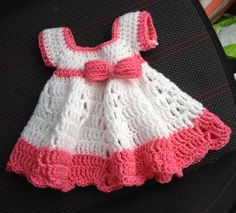 Pretty pleased with my first crochet baby dress attempt!  For the pattern here: https://www.youtube.com/watch?v=SVisIgXrSUQ
