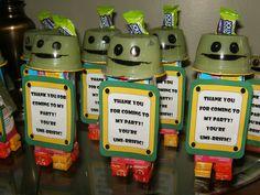 Team Umizoomi Bot take-home treats.  Juice box body, applesauce head, sticks of gum arms, starburst legs and jolly rancher antenna