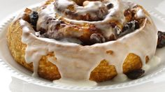 Rum-soaked raisins impart distinct flavor into these cinnamon rolls that make an ordinary breakfast extraordinary!