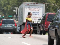 """A woman runs across Roosevelt Boulevard. Speed-enforcement cameras would """"dramatically change the driving culture"""" on Roosevelt Boulevard, Philadelphia police commissioner Charles Ramsey told state lawmakers on Monday, urging passage of a bill to legalize such cameras."""