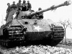 US troops drive a King Tiger German tank that has already obtained its US Army star.  captured weapons worldwartwo.filminspector.com
