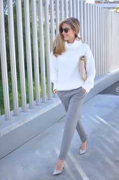 White oversize sweater, grey pants, animal print heels, maxi clutch