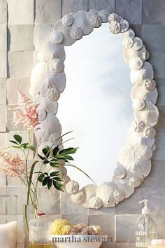 Sand dollars are pretty on their own, but when turned into a frame the results are spectacular. To make this seashell craft, follow our simple tutorial for this seashell mirror. #marthastewart #crafts #diyideas #easycrafts #tutorials #hobby