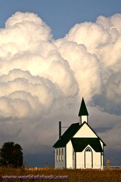 Thunderhead behind a country church.