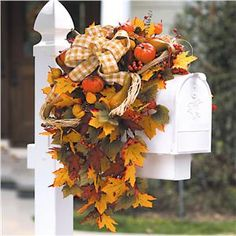 Fall Mailbox Swag - this would be better than the bungie cord I have on my mailbox now....