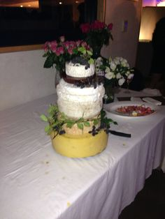 Wedding cake made of several cheeses! Best idea and was so well received at midnight with delicious bread & biscuits
