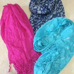 """SPRING STYLE  3 Lightweight Pashminas All 3 of these pashminas are light enough for spring and are a great way to add some color to any outfit! The sheer pink one measures about 40"""" x 70"""". The silver and blue leopard print pashmina is reversible and measures about 27"""" x 68"""" and the light blue one with silver stripes is about 25"""" x 68"""". Macy's Accessories Scarves & Wraps"""