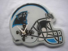Show your team spirit with a Carolina Panthers clock Football collectible is shaped like a helmet Sports memorabilia is ideal for the football fan in your life Color: blue. Christmas Gifts For Husband, Unique Christmas Gifts, Pro Football Teams, Football Helmets, Pittsburgh Steelers, Dallas Cowboys, Sports Toys, Fantasy Football, San Francisco Giants