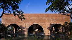 A grid of 24 red brick arches frames the interior of this Vietnam coffee shop by Wangstudio, which sits between a garden and a reflective pool of water Brick Architecture, Contemporary Architecture, Spas, Dong Hoi, Vietnam, Tadelakt, Coffee Design, Red Bricks, Stone Flooring