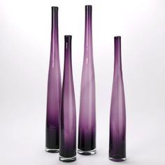 Purple accents lend a very glam and sexy vibe to a room, and these vases definitely fit the bill. Lithe Aubergine Vase