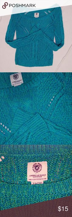 American Eagle Knit Sweater Rich colored blue/green American Eagle sweater. Very lightly used. Only worn a few times. The sweater sits on the edge of the shoulders and hugs the arms and body nicely. Please leave a comment if you need more pictures or information! American Eagle Outfitters Sweaters Crew & Scoop Necks