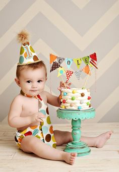 Baby boy / Toddler Cake Smash Birthday Outfit including a necktie diaper cover & party hat in Retro Fall Polka Dots. $39,85, via Etsy.