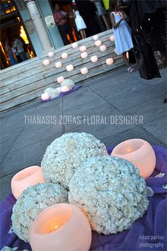 Church decoration.. Balls with white carnations and candles .