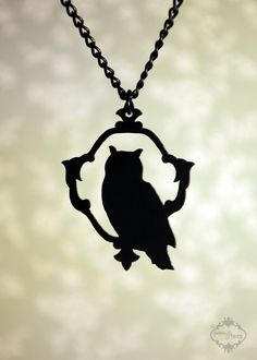 Black stainless steel owl silhouette pendant necklace.
