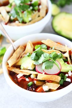Slow Cooker Black Bean Tortilla Soup Recipe on twopeasandtheirpod.com This easy vegetarian tortilla soup is a family favorite. It is made in the crockpot and is great for lunch or dinner.