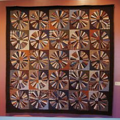 Beautiful Wagon Wheel quilt by Rhonda K. March ~ quilted by Dave March ~ displayed at the Springville Museum of Art in Utah.