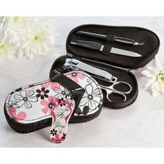 This Flirty Flip Flop Pedicure Set is a fun and practical favor for your wedding, bridal shower, or bachelorette party. The zippered, flip flop carrying case features a pretty black, white and pink floral design. #wedding #summer #daisydays