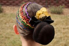 This one is officially my favorite St. Patty's Day hairstyle! You will need some rainbow colored ribbons, a black nylon, and some gold coins...
