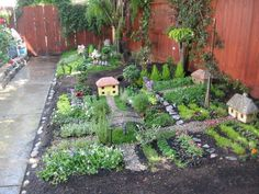 Most awesome fairy garden nice and big to decorate over and over-want one stone house, one stick house, one mushroom house