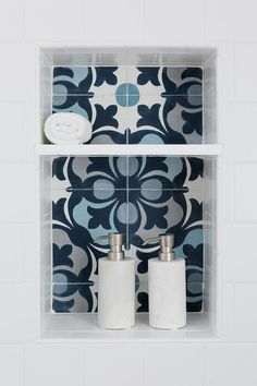 Transitional bathroom features a white subway tiled shower with a blue mosaic shower niche.