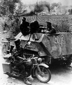 A motorcycle messenger reports to the crew of an Sd.Kfz. 250/5 Recon Platoon of the Nordland Division. This photograph was taken in July 1944 when the Soviets threw a series of massive tank attacks against the Narva bridgehead. Nordland Division with Estonian and Dutch Division put up furious resistance. In one battle, for example, they knocked out more than 100 T-34s that charged their lines.