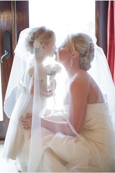 Love the lighting in this picture and the position of the veil. Mummy daughter kiss.