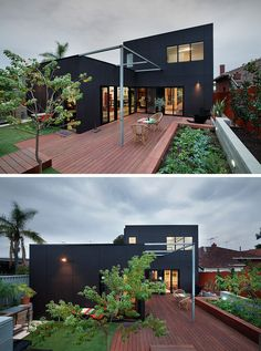 The two storey extension on this modern home is covered in black siding to give it a contemporary look. Black Architecture, Black House Exterior, Dark House, Forest House, Modular Homes, Architect Design, Facade, House Plans, House Design