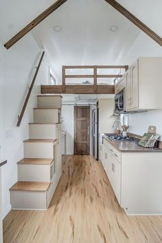 Above the kitchen and bathroom is the queen size bedroom loft with storage stair access.