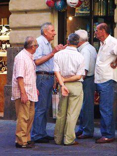 Italian men chatting on the street.