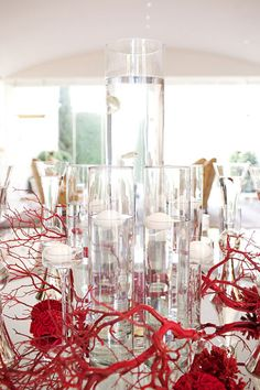 Everyone has seen sprayed branches in vases but we like the idea of vibrant painted branches on the table surrounding a simple centerpiece. Inexpensive way to add a pop of color.