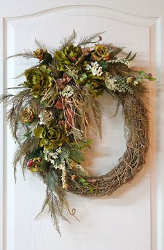 This elegant country wreath will be great for summer thru fall! In this wreath are three beautiful large green Peonies, small green Roses, Ferns, small white Hydrangeas, white berries and greens. A beautiful bow with streamers of raffia makes this a very unique wreath! Don't forget…..wreaths make wonderful gifts!
