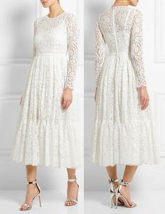 The Duchess chose her white Dolce & Gabbana Cotton-Blend Lace Dress. The midi-length white dress is an intricate piece with a nipped in waist and tiered swishy skirt. It's available at Net-A-Porter discounted from £5,995 to $3,597.